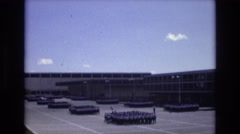 1968: a parade or military exercise next to a large building at daytime COLORADO Stock Footage