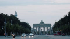 Locked down shot of Brandenburg Gate and TV Tower at sunset in Berlin Stock Footage