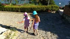 Two little beautiful girls in Nesebar, Bulgaria Stock Footage