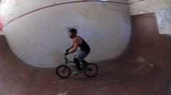 A young man riding a BMX bicycle. Stock Footage