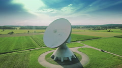 Satellite communication antenna dish parabolic ground station dramatic sky Stock Footage
