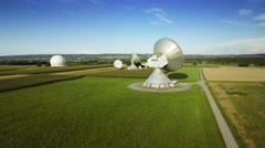 Parabolic satellite communication ground station green field aerial antenna dish Stock Footage