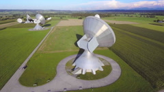 Parabolic satellite ground station communication antenna dish green field aerial Stock Footage