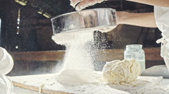 Mans hands sifting flour through a sieve for baking Stock Footage