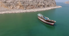 Following car passing over boat Musandam Sultanate of Oman Stock Footage