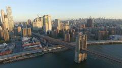 4k aerial view New York City fly away Brooklyn bridge Stock Footage