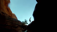 POV of a young man doing a backflip into a river watering hole. Stock Footage
