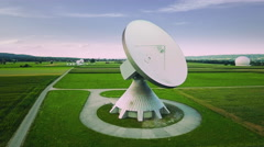 Parabolic satellite communication antenna dish ground station green field aerial Stock Footage