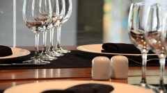 Table settings for fine dining at a restaurant in a modern hotel. Stock Footage