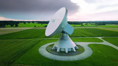 Satellite communication antenna dish parabolic ground station green field aerial Stock Footage