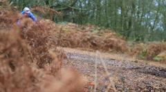 A man mountain biking on a singletrack dirt trail. Stock Footage