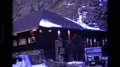 1969: at the base of the rocky mountain stand a building under ice cover Stock Footage