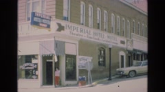 1969: big hotel beautiful cars parked moving road beautiful architecture design Stock Footage
