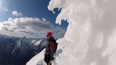 Mountain climbing in the snow using crampons and ice axes. Stock Footage