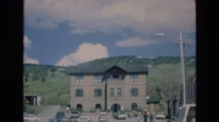 1969: car approaching a residential house with a mountain behind COLORADO Stock Footage