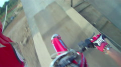 POV helmet cam view of motocross motorcycle riding and doing a jumping trick. Stock Footage