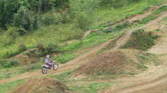 A man motocross motorcycle riding and doing a jumping trick. Stock Footage