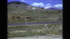 1969: rocky land grass houses roads electric poles and wires  Stock Footage