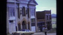 1969: man walking near house and car COLORADO SPRINGS COLORADO Stock Footage