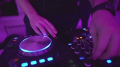 DJ Adjusting Mixer Controllers At Nightclub Stock Footage