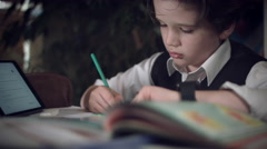 4K Hi-Tech Shot of a Child Doing Homework with Tablet on Stock Footage