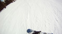 POV of a man snowboarding on a mountain in winter, slow motion. Stock Footage