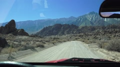 Driving on the dirt roads of Alabama Hills, Calif., flying dust Stock Footage