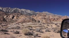 Driving on the dirt roads of Alabama Hills, Calif., tall Sierra's Stock Footage