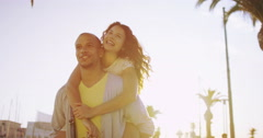 4K Summer in the city, happy couple having fun outdoors as the sun begins to set Stock Footage