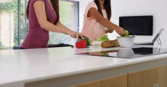 4k, Young couple making dinner together at home. Slow motion. Stock Footage