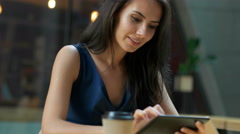 Working at the cafe. Young beautiful long hair woman sitting at the table and Stock Footage