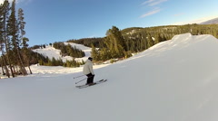 A skier does a 360 jump off a ramp at a ski resort. Stock Footage