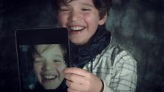 4K Hi-Tech Shot of a Child Doing a Selfie on his Tablet and Laughing Stock Footage