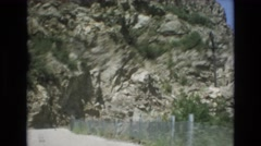 1969: a beautiful rugged, rocky mountain as seen from a moving vehicle COLORADO Stock Footage
