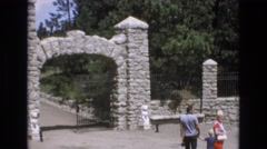 1969: the family waiting in front of a huge gate. COLORADO SPRINGS COLORADO Stock Footage
