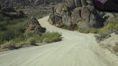 Down hill, Driving on the dirt roads of Alabama Hills, Calif. Stock Footage