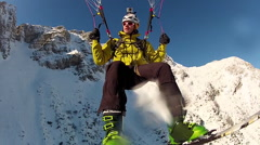 POV of a man speed riding with skis and a parachute on a snow covered mountain. Stock Footage