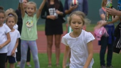 The Little Girl Runs to a Finishing Line Stock Footage