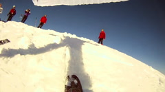 POV of a shadow and man speed riding with skis and a parachute on a snow covered Stock Footage
