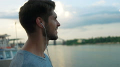 Man listening to music on the city center Stock Footage