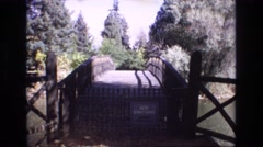 1967: a black metal gate in front of an entry way COLORADO SPRINGS BROADMOR Stock Footage