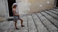 A woman in Portoferraio, Italy on the island of Elba. Stock Footage