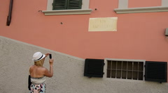 A woman taking a picture in Portoferraio, Italy on the island of Elba. Stock Footage