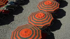 Umbrellas on the beach of Monterosso al Mare in the Cinque Terre region of Ligur Stock Footage