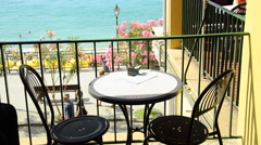 Cafe table and chairs near the beach of Monterosso al Mare in the Cinque Terre r Stock Footage