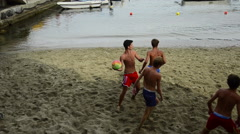 Boys playing soccer / football on the beach of Porto Venere, Liguria, Italy Stock Footage