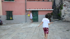 Boys playing soccer / football in Porto Venere, Liguria, Italy Stock Footage
