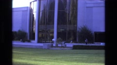 1966: nice big white building with glass panes and round design. LAKE CITY UTAH Stock Footage