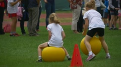 Two Little Girls Hurry to Come to a Finish Line Stock Footage