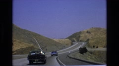 1965: hilly road traveling road vacation trip CENTRAL COAST CALIFORNIA Stock Footage